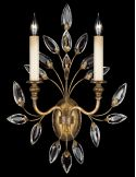 Sconce in antiqued warm gold leaf with stylized faceted crystal leaves