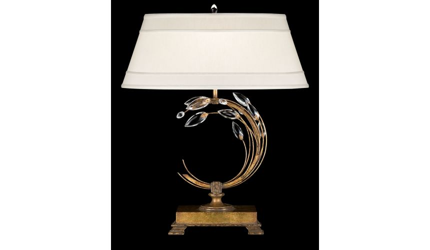 Lighting Left-side facing table lamp in gold leaf with stylized faceted crystal leaves