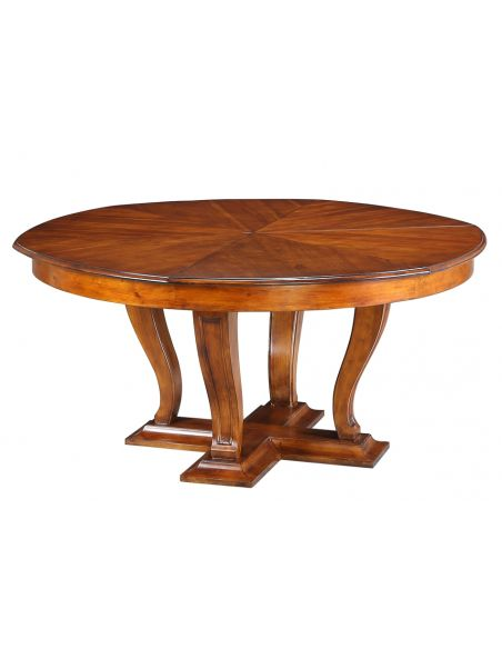 Dining Tables Transitional style round table with self storing leaves.