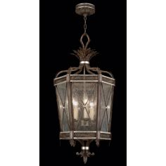 Lantern in hand painted driftwood finish on metal with silver leafed accents