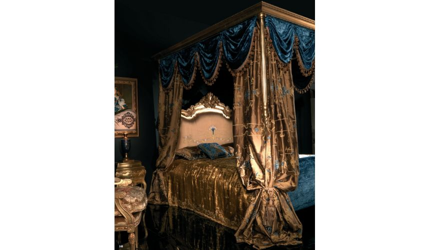 Master bed with canopy and embroidered headboard.