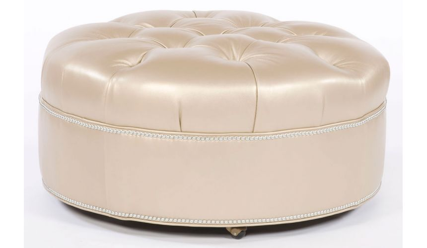 Luxury Leather & Upholstered Furniture Tufted round ottoman. Grand home furnishings. 82