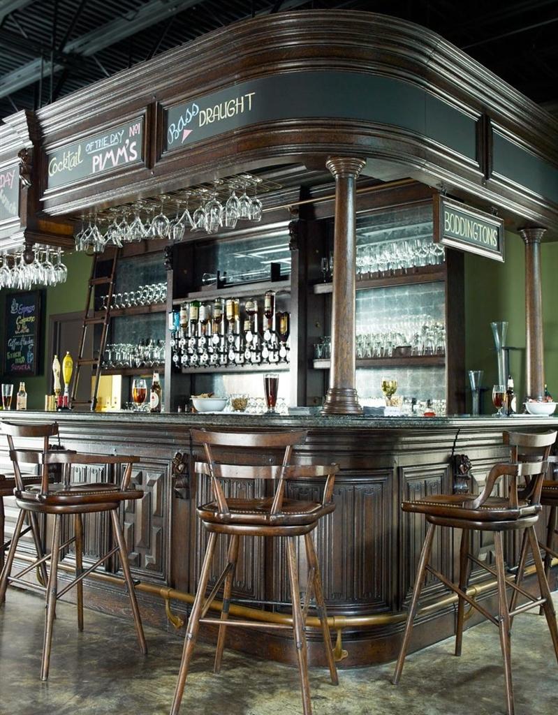 https://bernadettelivingston.com/8526/home-bar-oak-wood-granite-top-with-brass-rail-and-canopy.jpg