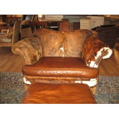 Hunting lodge furniture, hair hide and twisted leather fringe, chair