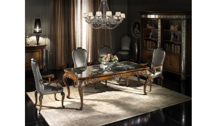 Dining Tables Fine carvings and a etched glass top highlight this dining set.
